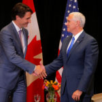 Canadian Prime Minister Justin Trudeau and United States Vice President Mike Pence meet on the sidelines of the National Governors Association summer meeting in Providence, Rhode Island, on July 14, 2017.