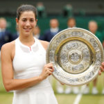 Spain's Garbine Muguruza poses with the Wimbledon trophy as she celebrates winning the final against Venus Williams.