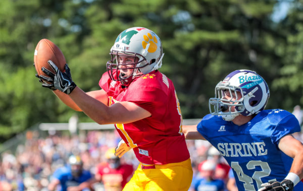 Mattanawcook Academy's Carter Ward attempts to haul a pass while being defended by Deering's Rob Dacey during the Maine Shrine Lobster Bowl Classic at Thornton Academy's Hill Stadium in Saco on Saturday.