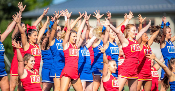 Cheerleaders for the East and West teams perform during the Maine Shrine Lobster Bowl Classic at Thornton Academy's Hill Stadium in  Saco on Saturday.