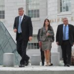 Gov. Paul LePage (right) exits the State House with Press Secretary Adrienne Bennett and other members of the executive staff, Aug. 14, 2013.