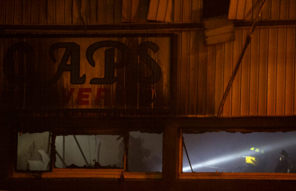Area firefighters work to extinguish a blaze at Cap's Tavern in Brewer, July 13, 2017.