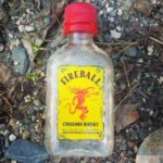 A 50-milliliter bottle of Fireball Whisky sits on the ground by Route 1 in Orland in this 2014 photo.