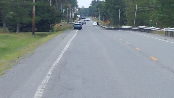 Police blocked off a large section of Route 2 shortly before noon on Monday as they attempted to diffuse a standoff situation in the vicinity. The section of roadway that was closed to traffic ran from just north of the Knights of Columbus Hall to the Sargent Materials concrete and aggregate plant.