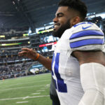 Dallas Cowboys running back Ezekiel Elliott (21) smiles after the game against the Baltimore Ravens at AT&T Stadium. The Cowboys beat the Raven 27-17.
