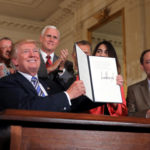 """U.S. President Donald Trump signs a proclamation as he attends a """"Made in America"""" products showcase event at the White House in Washington, U.S., July 17, 2017."""