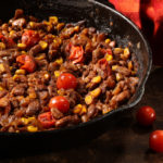 Beans are cooked with garlic, tomatoes, corn and chile powder, all of it doused with a generous pour of a malty beer.