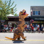 A person in a Tyrannosaurus Rex costume walks during Independence Day celebrations in Wisconsin. A new study revealed that the Tyrannosaurus rex wasn't much of a runner. In fact, it couldn't run at all. Instead, the animal speed-walked.