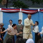 "The cast of ""Tintypes"" rallies around President Teddy Roosevelt (Andre Blanchard). The musical will be performed by Cold Comfort Theater through Saturday in Wales Park in Belfast."