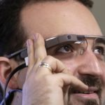 Developer Maximiliano Firtman wears the prototype device Google Glass before a news conference ahead of the 2013 RigaComm event in Riga, Nov. 4, 2013.