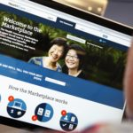 A man looks over the Affordable Care Act (commonly known as Obamacare) signup page on the HealthCare.gov website. Several health insurance companies are considering raising their rates in 2018.