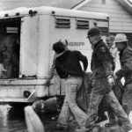 The 28th body was uncovered in John Wayne Gacy's back yard in the Norwood Park neighborhood of Chicago as officials transfer it to a sheriff's van, March 9, 1979.
