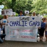 Supporters of the the parents of critically ill baby Charlie Gard, Connie Yates and Chris Gard, hold a banner before handing in a petition to Great Ormond Street Hospital, in central London, Britain July 9, 2017.