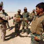 A U.S. Marine (L) shakes hand with Afghan National Army (ANA) soldiers during a training exercise in Helmand province, Afghanistan July 5, 2017.