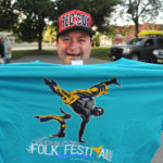 Robert Morris of Bangor proudly shows off the t-shirt he received for signing up to volunteer during the 2014 American Folk Festival in Bangor. It was the second year for Morris to volunteer.