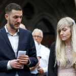 Charlie Gard's parents Connie Yates and Chris Gard read a statement at the High Court after a hearing on their baby's future, in London, Britain July 24, 2017.