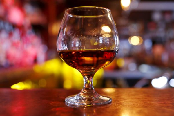 A glass of cognac is pictured on a bar in Manhattan in a November 2015 file photo.