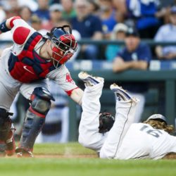 Seattle's Ben Gamel slides into home plate under the tag of Boston's Christian Vazquez to score a run during the third inning of Monday's game at Safeco Field in Seattle. Joe Nicholson | USA TODAY Sports