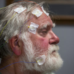 A man from Orono sits with a head full of electrodes that will monitor his brain activity while undergoing a sleep study at St. Joseph Healthcare Center for Sleep Medicine in Bangor.