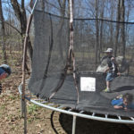 Sharon Bulley of Houlton keeps an eye on her three adopted children Charlie, Jacob and Isaiah as they jump on a trampoline Friday afternoon. The three boys were once under foster care with Sharon and her husband John before the Bulleys adopted the boys.