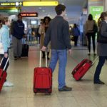 People check flight times at LaGuardia Airport in New York November 21, 2012.