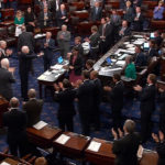 A still image from video shows U.S. Sen. John McCain, R-Arizona, who had been recuperating in Arizona after being diagnosed with brain cancer, acknowledging applause as he arrives on the floor of the U.S. Senate after returning to Washington for a vote on health care reform in Washington, U.S., July 25, 2017.