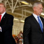 U.S. President Donald Trump (L) is introduced by Defense Secretary James Mattis (R) during the commissioning ceremony of the aircraft carrier USS Gerald R. Ford at Naval Station Norfolk in Norfolk, Virginia, U.S. July 22, 2017.
