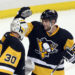 Apr 23, 2016; Pittsburgh, PA, USA; Pittsburgh Penguins goalie Matt Murray (30) and defenseman Brian Dumoulin (8) celebrate after defeating the New York Rangers 6-3 in game five of the first round of the 2016 Stanley Cup Playoffs.