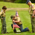 Boy Scouts plant flags in the Maine Veterans Memorial Cemetery in Augusta.