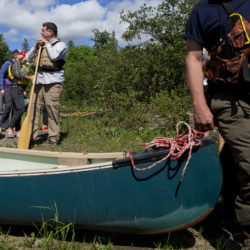 U.S. Secretary of the Interior Ryan Zinke (left) prepares to go for a canoe trip during a tour of the Katahdin Woods and Waters National Monument. The visit was the start of a four-day visit to New England.
