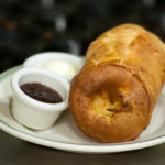Popovers are typically served with butter and jam.