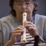 Sheila Swazdowich plays a recorder at the Somerset Place in Brewer Monday. She was among the participants of a class teaching seniors to read music and play the recorder.