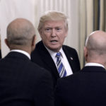 U.S. President Donald Trump  greets Microsoft CEO Stya Nadella, left, and Amazon CEO Jeff Bezos during a meeting of the American Technology Council on Monday, June 19, 2017 in the State Dining Room of the White House in Washington, D.C.