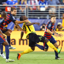 United States midfielder Graham Zusi (19) pulls down Jamaica forward Darren Mattocks in the second half during the CONCACAF Gold Cup final Wednesday at Levi's Stadium in Santa Clara, California. Zusi would receive a yellow card penalty on the play. The U.S. won 2-1.