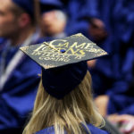 A graduate's cap making fun of student debt is seen during the University of Maine's 215th Commencement at Alfond Arena in Orono in May.
