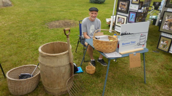 Fort Fairfield native Pete Robinson introduced his new book &quotHarvest Time: A Day in the Life of Picking Potatoes&quot at the Potato Blossom Festival in his hometown this month.