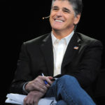 Conservative talk show host Sean Hannity does the 15th anniversary of his Fox News show ''Hannity'' at Centennial Olympic Park in Atlanta, Georgia, Oct. 7, 2011.