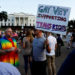 Demonstrators gather to protest U.S. President Donald Trump's announcement that he plans to reinstate a ban on transgender individuals from serving in any capacity in the U.S. military, at the White House in Washington, U.S. July 26, 2017.