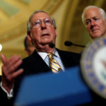 Senate Majority Leader Mitch McConnell, accompanied by Senator John Cornyn (R-TX) and Senator John Barrasso (R-WY), speaks with reporters following the successful vote to open debate on a health care bill on Capitol Hill in Washington, U.S., July 25, 2017.