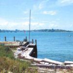 "A granite ""engineer's"" wharf on House Island offers a view of Portland."