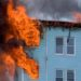 Rescue crews fought a fire at a three-story apartment building on Cumberland Street in Rumford Saturday afternoon. Between 16 and 20 people have been displaced by the fire, according to the Red Cross. (Tony Wentzell photo courtesy of CBS 13)