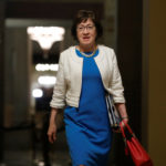 Sen. Susan Collins, R-Maine, walks to the Senate floor ahead of a vote on the health care bill on Capitol Hill in Washington, July 27, 2017.