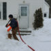 Curtis Emerson prepares to pump 40 gallons of oil into the house of a family on heat assistance in Ellsworth on February 1, 2011.