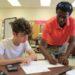 Berekit Bairu tutors a student in math at Portland's Deering High School.