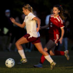 Bangor's Lauren Young (left) looks to clear the ball before Camden Hills' Bryn Anderson can attack in a November 2016 game.