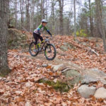 BANGOR, Maine -- 11/15/16 -- Sarah Vickers of Holden, a member of the Penobscot Region New England Mountain Bike Association, rides new single track mountain biking trails on Nov. 15, in Essex Woods in Bangor.  The trail was constructed in October by volunteers of PR NEMBA and the support of Bangor Parks and Recreation Department. (Aislinn Sarnacki | BDN)