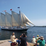 Schooner Victory Chimes takes a pass by the Rockland Breakwater Lighthouse.