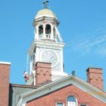 A steeplejack can be seen descending the Aroostook County Superior Court clock tower earlier this month.