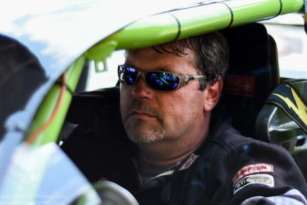 Andy Saunders of Ellsworth sits in his No. 01 car while waiting to compete in a recent race at Oxford Plains Speedway.
