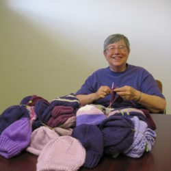 Brewer Library Knitting Group Collects Purple Infant Hats